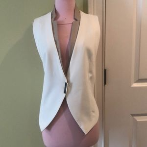 White vest with faux leather trim